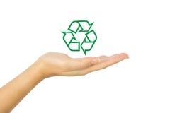 Återanvänd symbolen på handen Arkivfoto