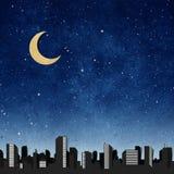 återanvända silhouettes för stadshantverkpanorama papper Arkivfoto