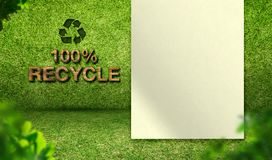100% återanvänder ord med tomt papper på rum för grönt gräs, ekologi c Arkivbild