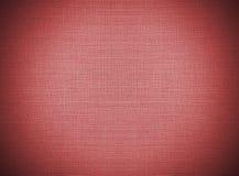 Återanvänder rött abstrakt begrepp för karaktärsteckningen den pappers- modellen snör åt på tygbakgrundstextur, tappningstil Royaltyfria Foton