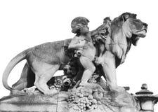Återgivning av en pojke och ett lejon som isoleras på vit, Paris, Frankrike arkivbilder