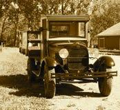 Återställda antika Ford Truck In Sepia Arkivbilder