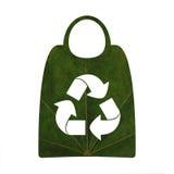 Återvinningsymbol- och shoppingpåsar Royaltyfria Bilder