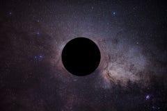 Åtlöjet av det svarta hålet framme av den mjölkaktiga vägen fotografering för bildbyråer