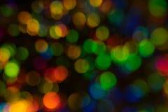 Åtskillig färgrik bakgrund för fläckbokehljus arkivbilder