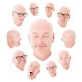 Åtskilliga framsidor av en skallig man royaltyfri bild