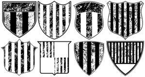 åtta görade randig grungesköldar Arkivbild