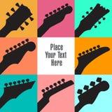 Åtta gitarrheadstocks inramar detta vita utrymme Arkivbild