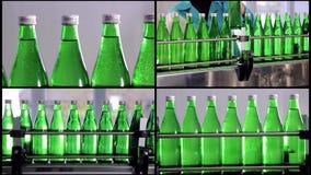 水生产拼贴画线  矿泉水的绿色瓶移动沿着自动生产线 水 股票录像