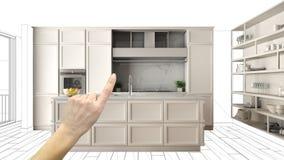 未完成的项目,建设中草稿,概念室内设计剪影,指向有图纸的手真正的经典厨房 免版税库存图片
