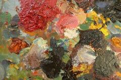 有不同的饱和的颜色的艺术性的颜色的老调色板 顶视图 免版税库存图片