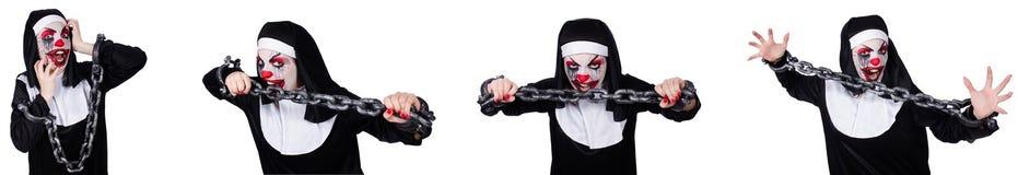 有在白色隔绝的手铐的奇怪的女性尼姑 免版税库存照片