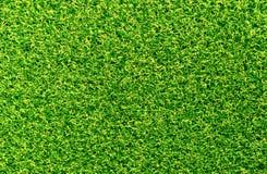 有绿色和黄色软的休息的背景地毯 免版税库存照片
