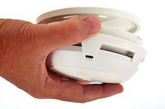投入烟检测器在特写镜头 库存照片