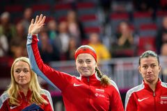 戴安娜Marcinkevica,在世界小组II第一场圆的比赛期间的阿廖娜奥斯塔片科和Anastasija Sevastova 免版税库存照片