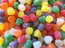明亮地色的胶下落糖果顶视图背景  免版税库存照片
