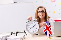 时间管理概念的女性英语语言语文教员 库存照片