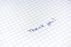手写的题字由于在板料的蓝色笔在笼子 免版税库存照片