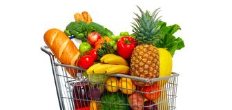 手推车用果子和豆类 免版税库存照片
