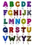 拉丁字母大胆的字体由与下跌的下落的五颜六色的釉制成在高分辨率 向量例证
