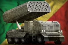 火箭队火炮,有灰色伪装的导弹发射装置在刚果国旗背景 3d例证 库存例证