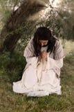 祷告在橄榄庭院里  库存图片