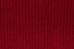 红色羊毛编织了背景 免版税库存图片