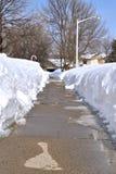 熔化在边路的雪 图库摄影