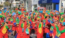 People in carnival costumes walking along a street