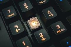由后照的机械键盘数字按钮细节射击了 免版税库存图片