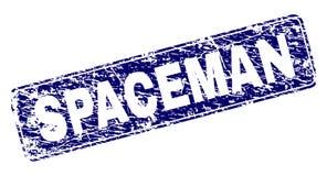 被抓的太空人构筑了被环绕的长方形邮票 免版税库存照片