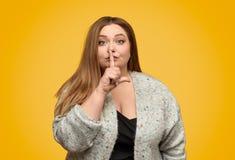 要求肥满的妇女是安静的 库存图片