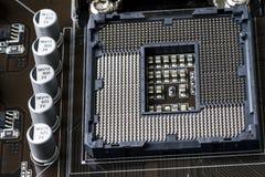 计算机板的片段 在前景插口在CPU下 顶视图 关闭 免版税图库摄影