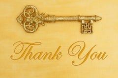 谢谢与手画困厄的金子的消息与贿赂 库存图片