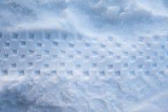 轮子从在雪的一辆自行车表示 库存照片