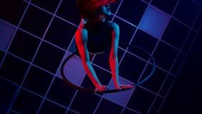 舞蹈和杂技的概念 空中箍的年轻美女与颜色背后照明 影视素材