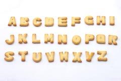 薄脆饼干曲奇饼集合充分的英语字母表形状  免版税库存图片