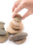 È isolato delle pietre dell'equilibrio lo zen per la stazione termale Immagini Stock