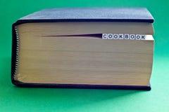 È libro con il libro di cucina di parola Immagini Stock
