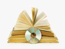 È molti libri ed un compact disc Immagine Stock Libera da Diritti