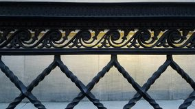 Wrought iron railing widescreen view with historic stone building background royalty free stock photos