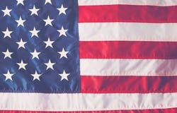 4ème des décorations de juillet sur le fond de drapeau américain Images libres de droits