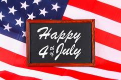 4ème du texte heureux de Jour de la Déclaration d'Indépendance de juillet sur le drapeau des Etats-Unis d'Amérique Photos stock