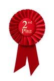 2ème rosette de ruban d'endroit de rouge Images stock