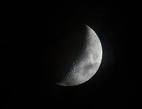 1ère lune de quart photographie stock