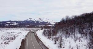 鸟瞰图深刻的冬天农村国家风景飞行沿离开的路 影视素材