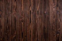 黑暗的木背景,概略的纹理 库存照片