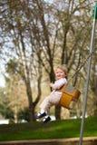 Één Éénjarige op Schommeling Stock Foto