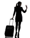 Achter menings het bedrijfsvrouw reizend groeten silhouet royalty-vrije stock fotografie