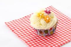 Één cupcake boterroom Stock Foto